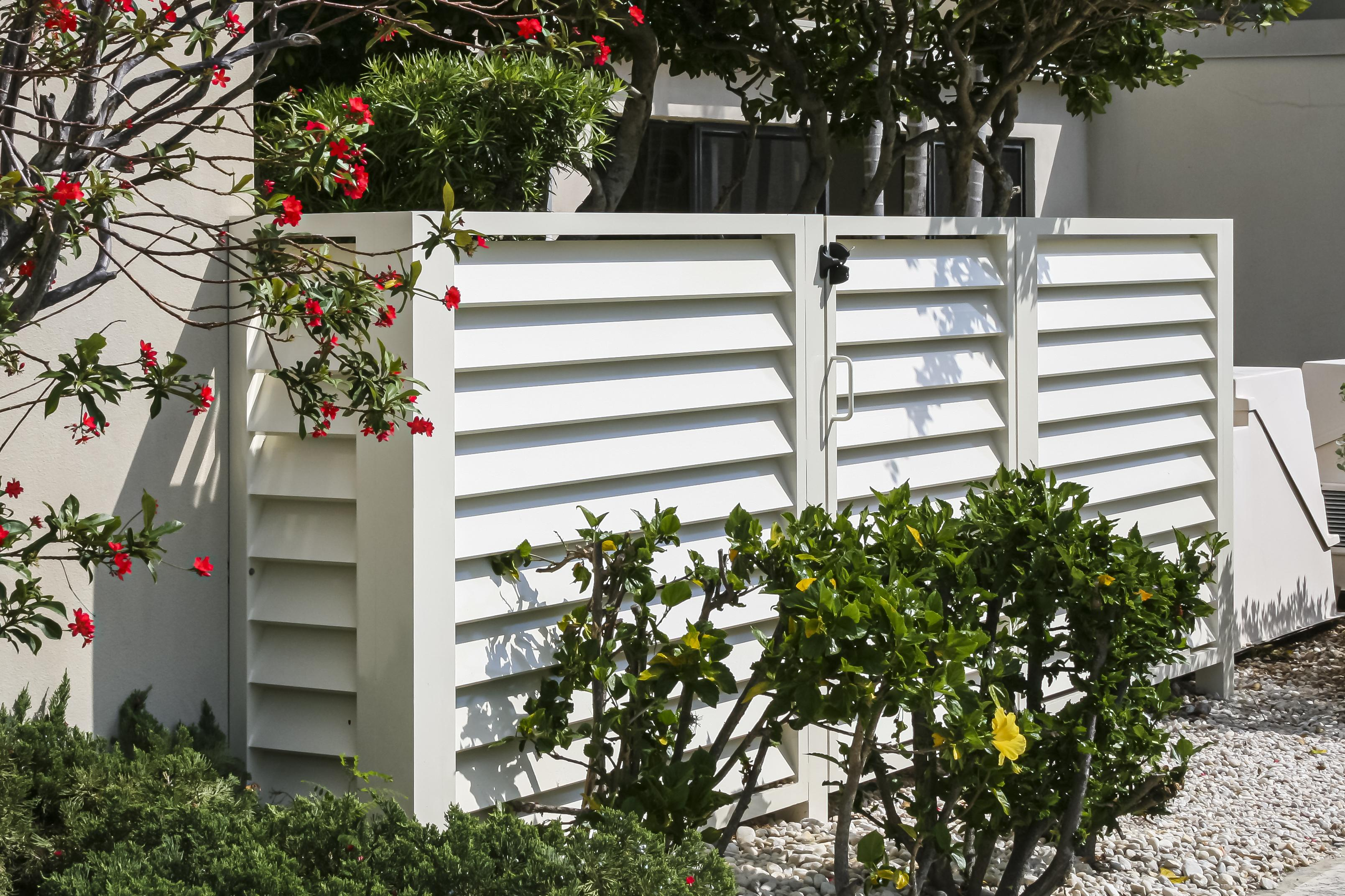 white louver fence and gate